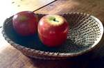Toy teaset inside wooden Apple